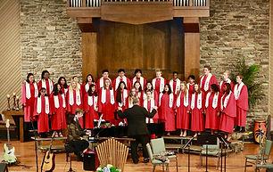 Students sing in the San Cielo choir for a church program.
