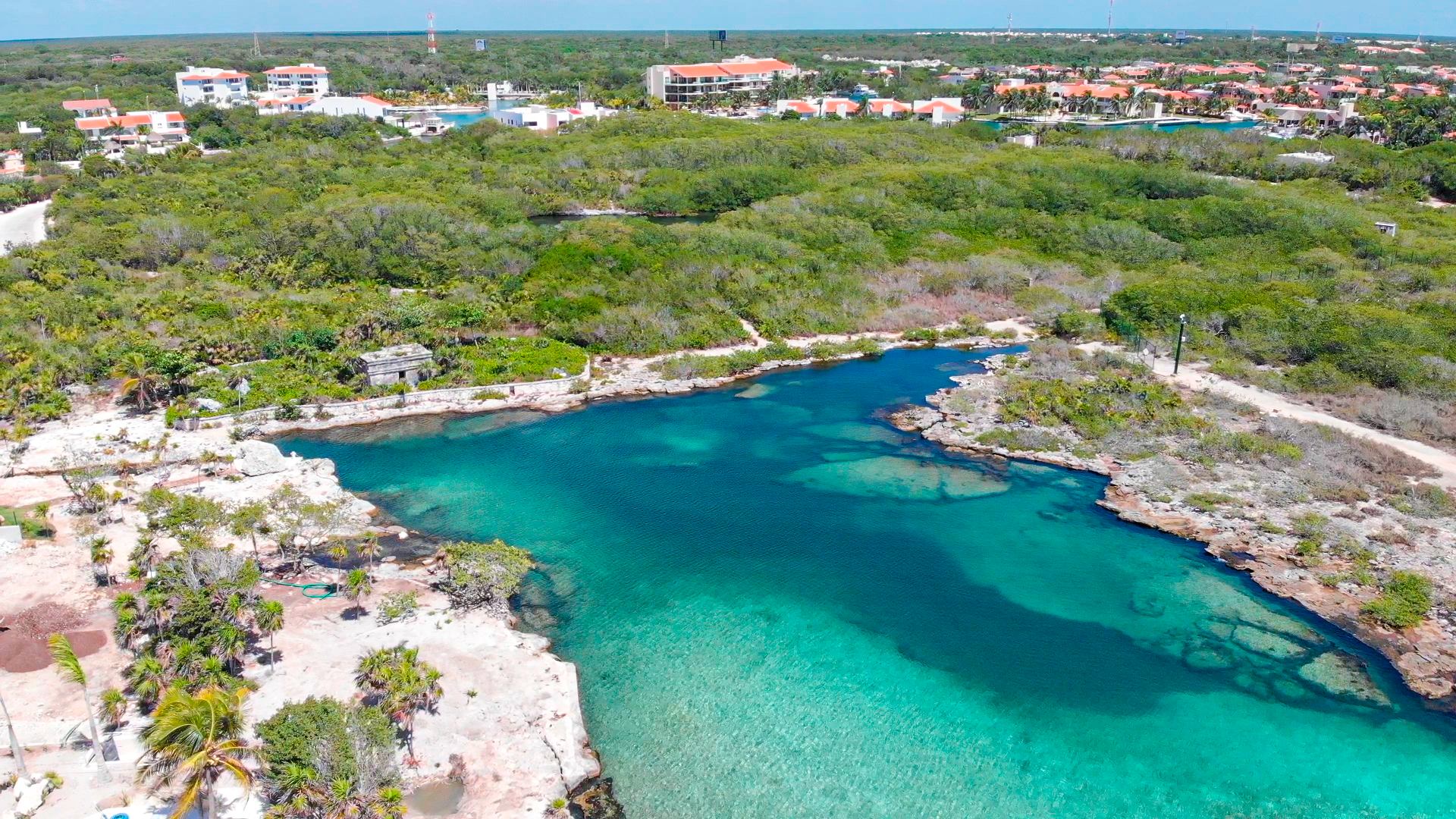 "Two Residential waterfront Lots for sale at inlet ''La Caleta''next to an authentically Mayan Temple and a Cenote. A total of only 7 waterfront lots are allowed on this unique gated development inside of Puerto Aventuras, a gated Beach, Marina and Golf Resort community in the Mexican Caribbean between Playa del Carmen and Tulum. Great investment opportunity for building two homes or one Large Ocean Front Residence. You also can purchase an additional marina front lot one minute across the street to have your private yacht in your ""backyard"". The lots are within the new phase 4 of Puerto Aventuras; both have a spectacular view to the turquoise water of this inlet, Mayan Rivera. Puerto Aventuras is a gated community with 24 hour security, beach club, tennis courts, marina, golf, shopping area, restaurants and sailing club."