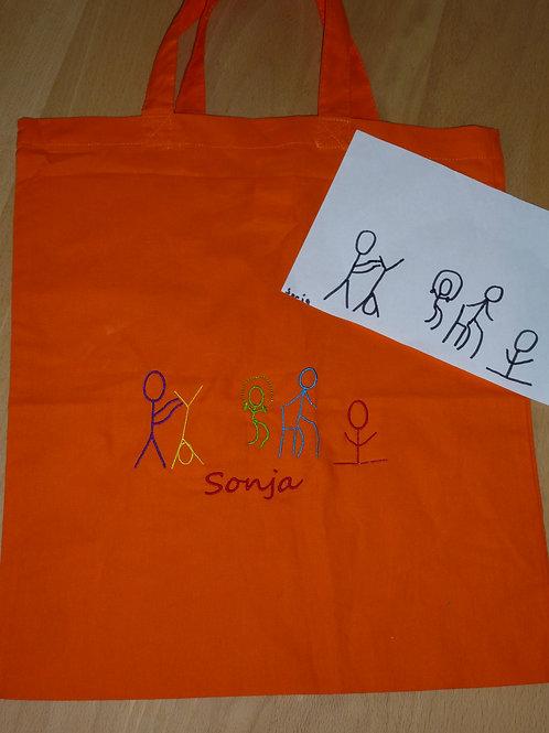 Zeichnung nach Ihren Wünschen auf orangen Stoffbeutel gestickt