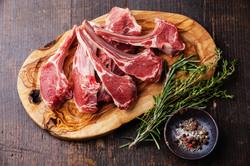 Raw Fresh Lamb Meat Ribs And Seasonings On Dark Wooden Background