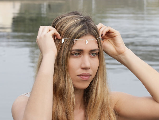 model try a silk necklace on her head