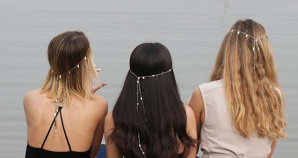 Models with silk necklace