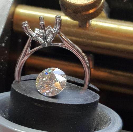 Setting clients diamond in new mount.