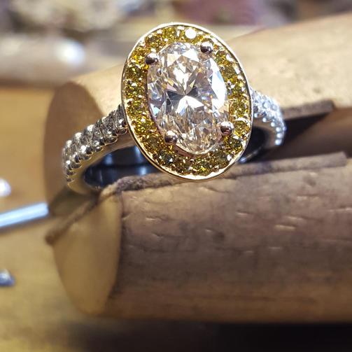 Oval diamond Halo Ring Yellow Diamond detail.