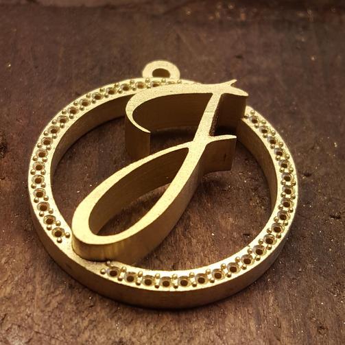 Initial pendant waiting for diamonds