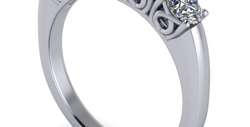 An anniversary ring set with five round brilliant cut diamonds.