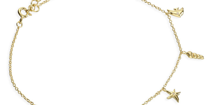 gold plated 'Under the Sea' anklet featuring a fish, starfish, shells and coral.
