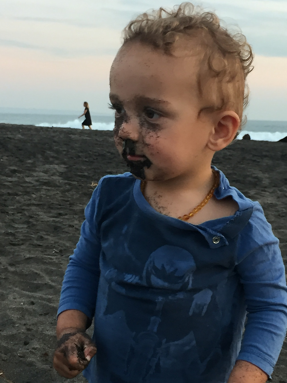 Marlow enjoying the black sand a little too much!