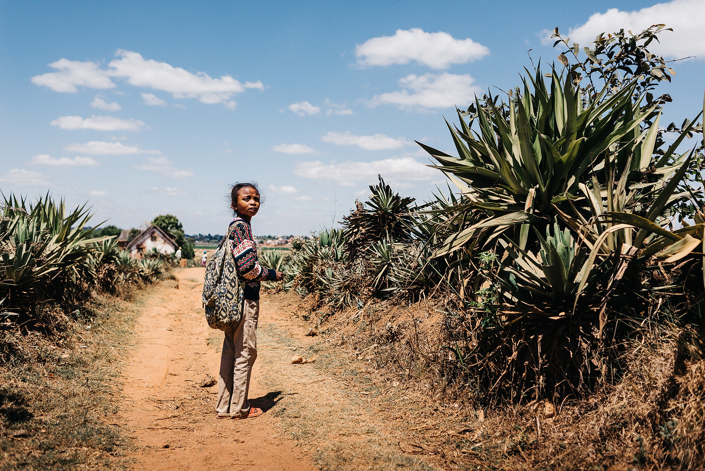 Rojo is sponsored from overseas to be able to go to school here in Ambovo. She lives at the edge of the paddy fields with her mother and sister, Antananarivo, Madagascar. Photo: David Vogt.