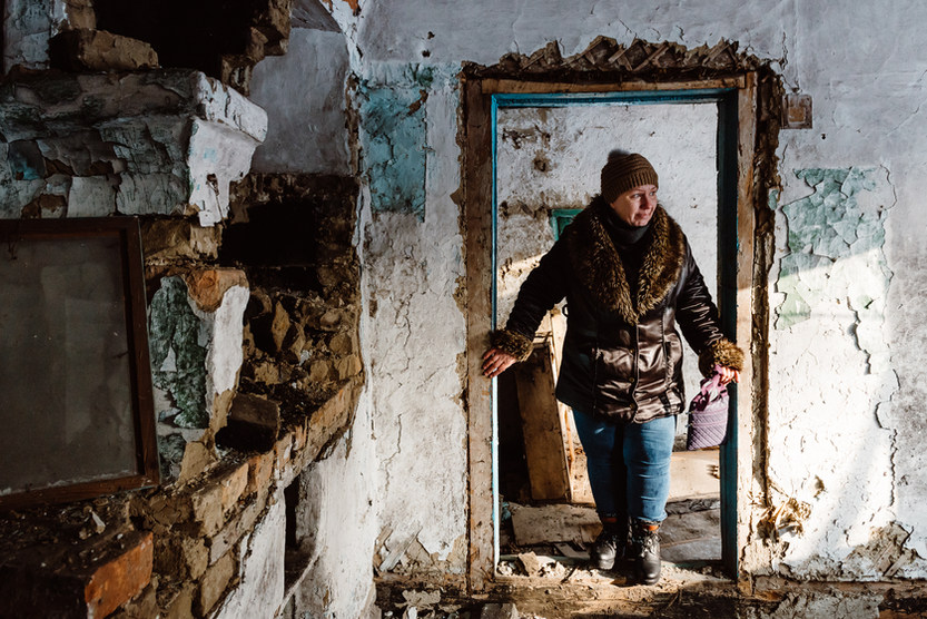 Olga Avdeenko, witness to the Chernobyl disaster, visiting her former home within the forbidden zone, Belarus. Photo: David Vogt.