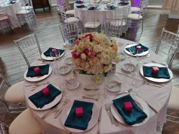 Fushia and forest green table setup - @101eventsatl