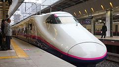 TOKYO - MAY 4Travelers board Shinkansen.