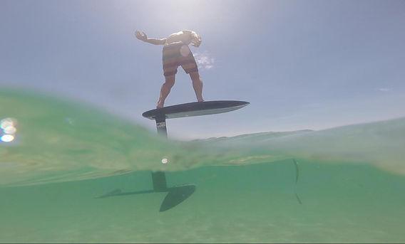Konrad over under surf foil Kauai Ohau Hawaii