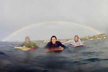 Rainbow surfing Poipu Kauai