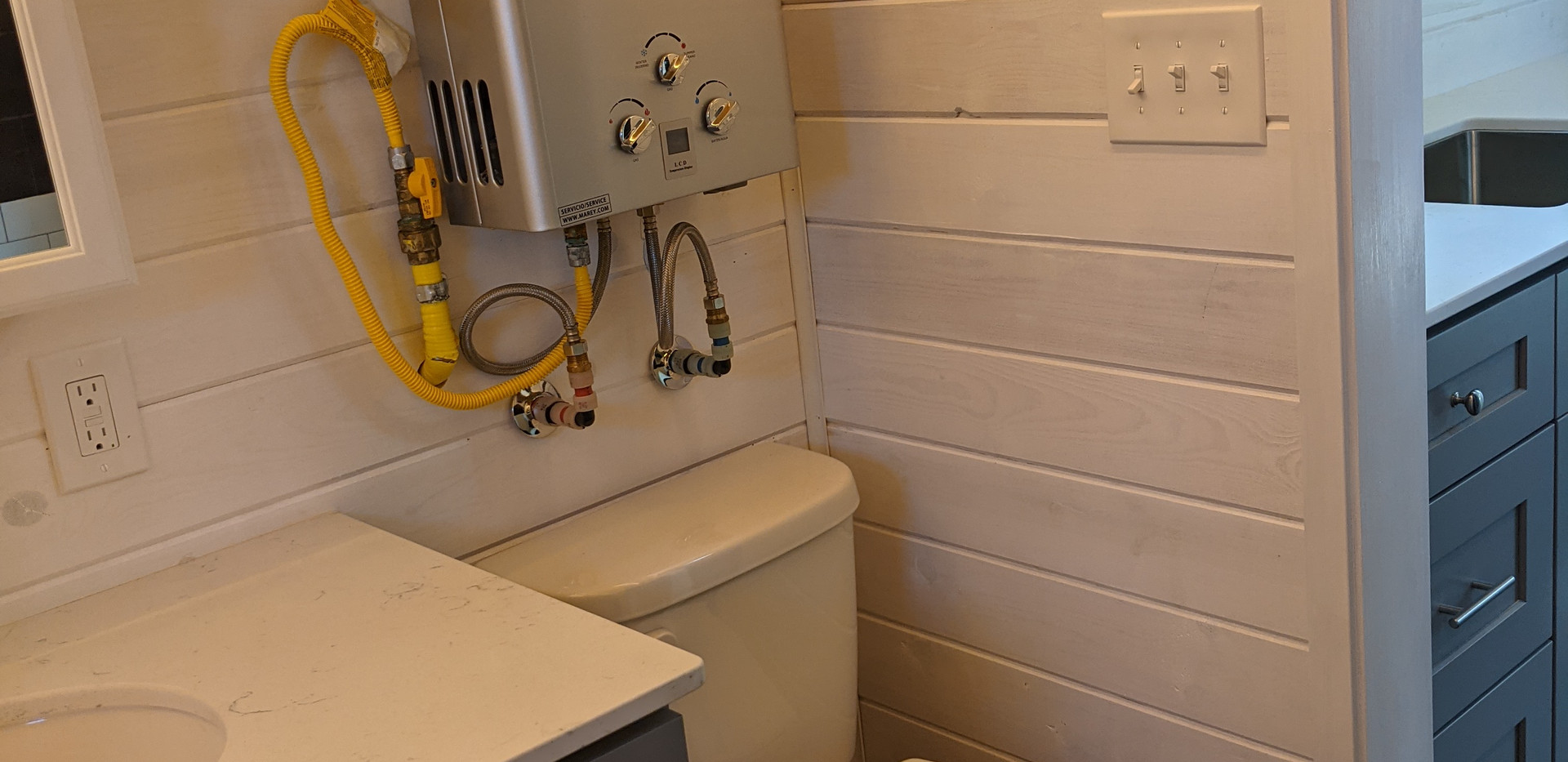 Flush Toilet and On Demand Water heater