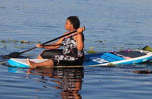 Jasmine on paddleboard - zoomed.JPG