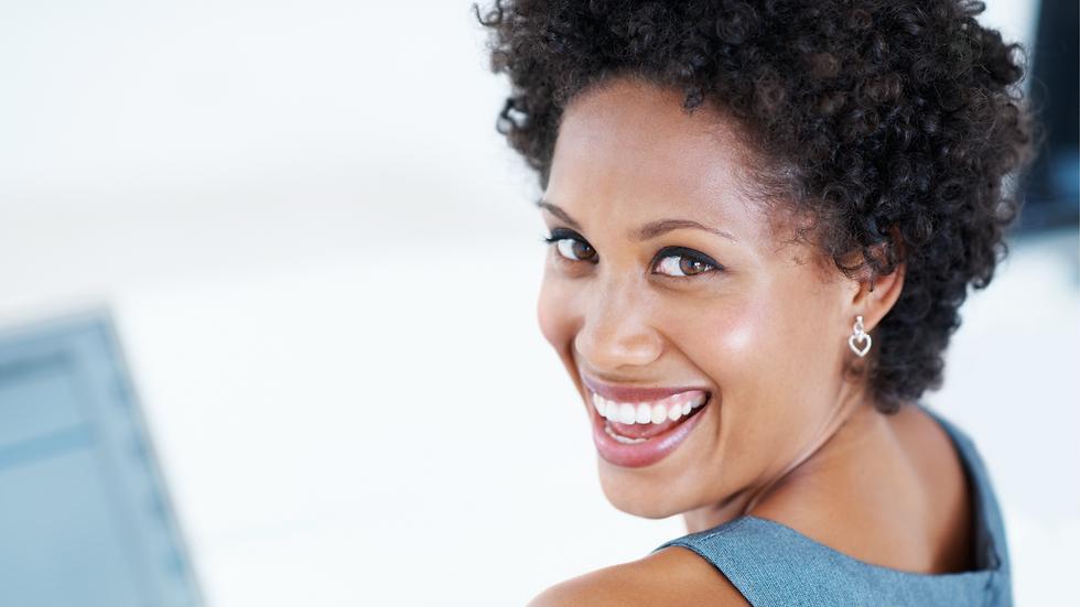 woman smiling at computer.png