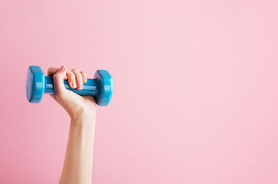 Womans hand holding blue dumbbell isolat