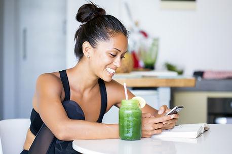 Woman drinking a homemade green detox ju