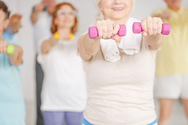 Close-up of older woman exercising shoul