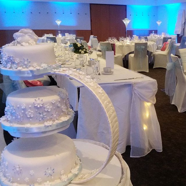 Lovely 3 tier wedding cake on g shaped stand complete with sugar flowers