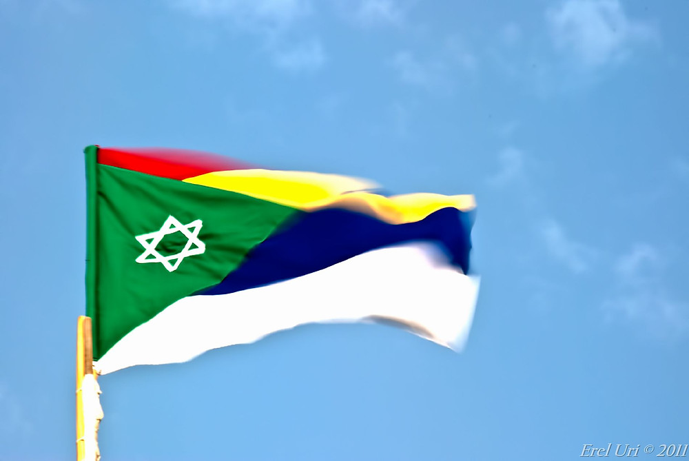 The Druze flag with a Star of David, symbolizing the Blood Bond with the State of Israel
