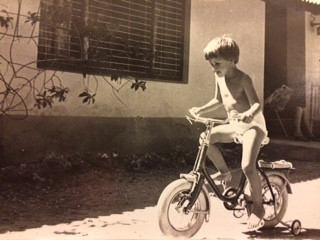My five year old self, riding my bike in front of our house in Dar es Salaam