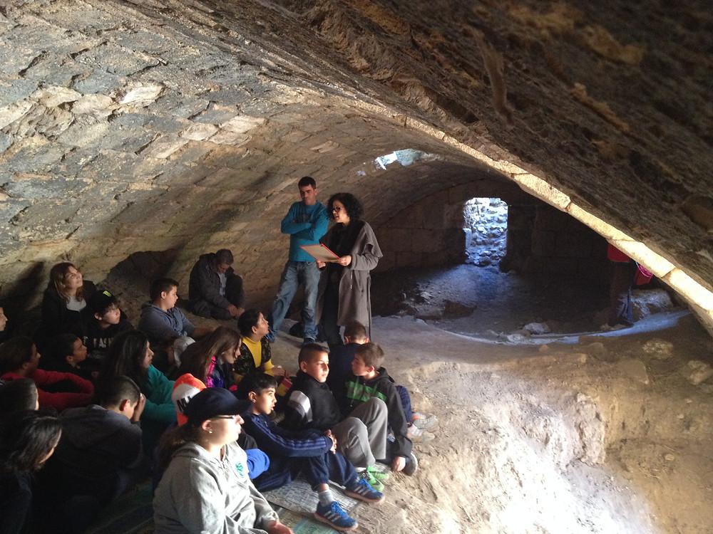 Israeli school children on a visit to the underground ruins of a Crusader farm building on Tel Hannaton