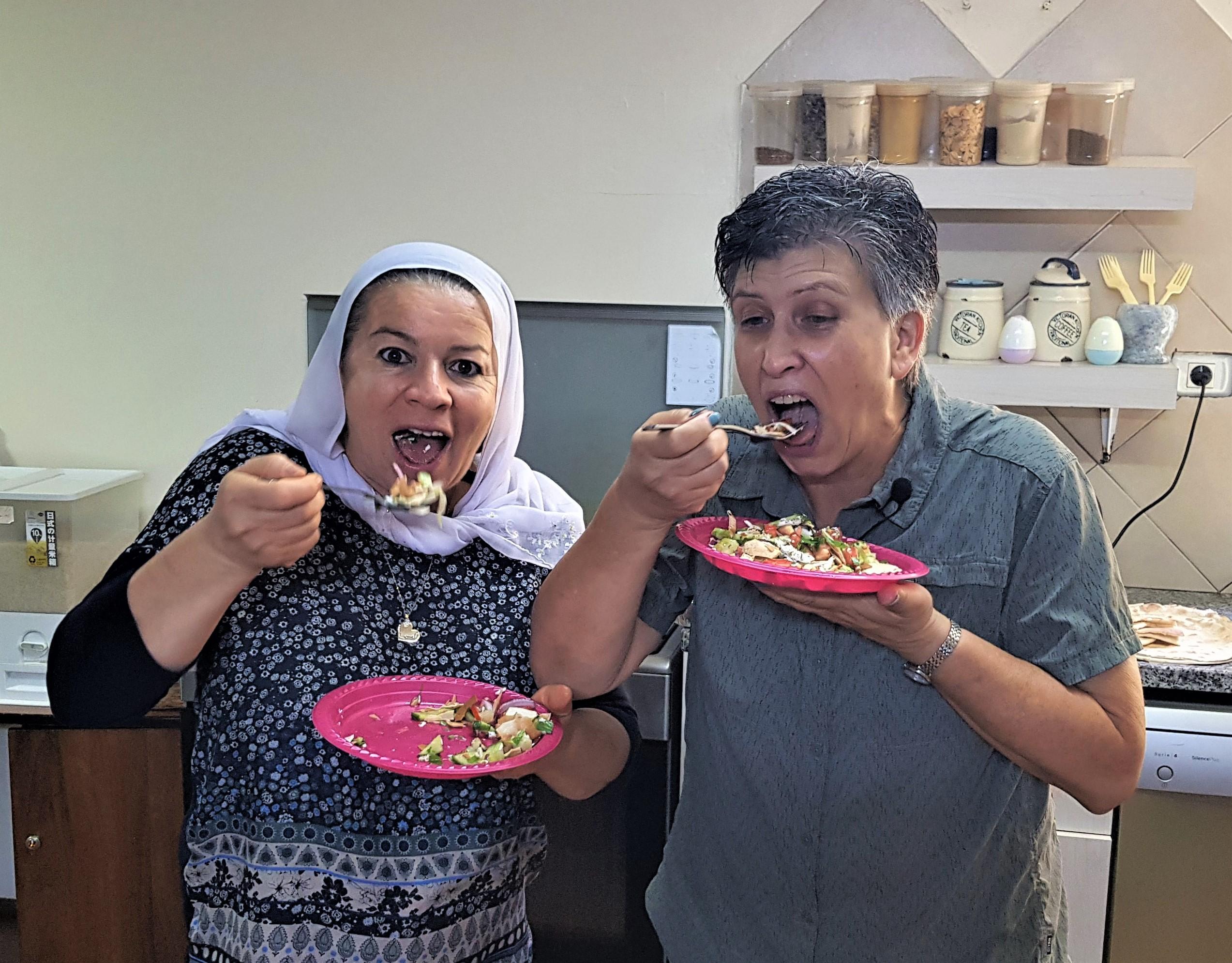 Anat and Ebtesam eating fattoush