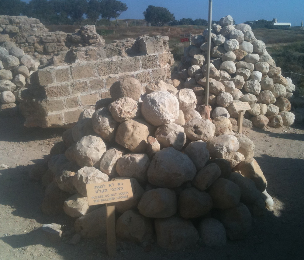 A pile of some of the ballistic cannonballs found in the ruins of the fortress