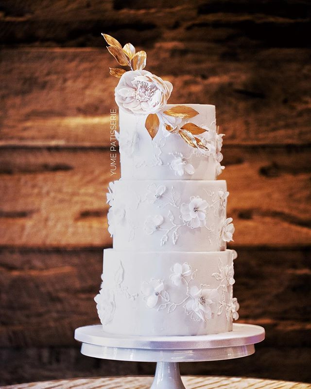 White on White wedding Cake with edible sugar flowers by Chef Amber Singapore