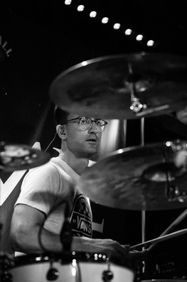 Black and white image of InMe Drummer at Bristol Exchange