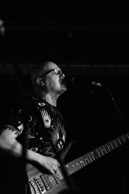 Black and white gig photograph of InMe guitarist at Bristol Exchange
