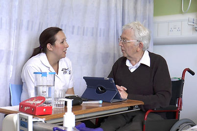Adult speech therapist with patient