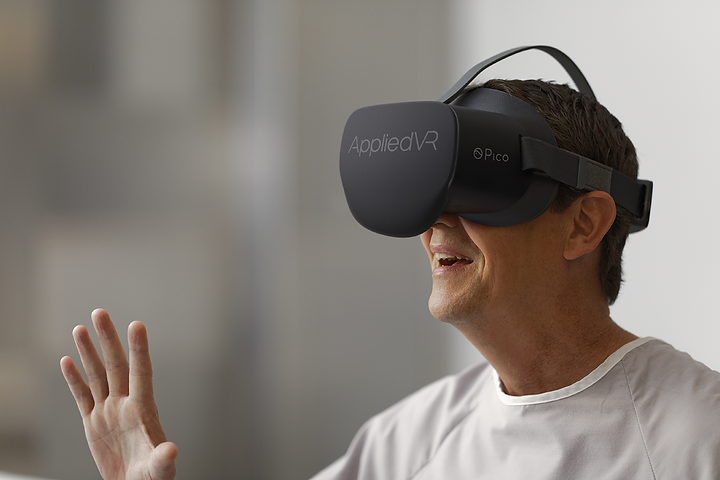 Image of an older person wearing virtual reality goggles