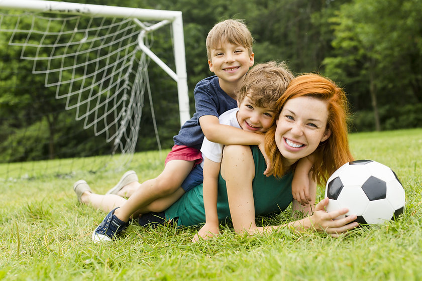An Image of family, mother and son playi