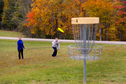 People playing disc golf at Pipestem Resort State Park