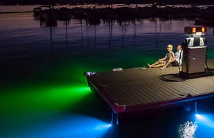 A dock illuminated with underwater LED lights made by Lifeform LED