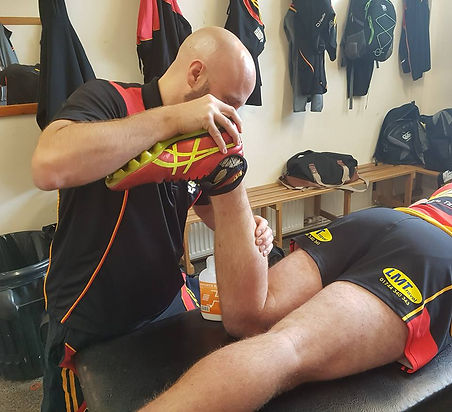 Carl treating injured rugby player Injury Hub Sports Therapy