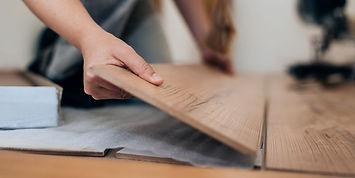 woman-installing-laminate-flooring-royal