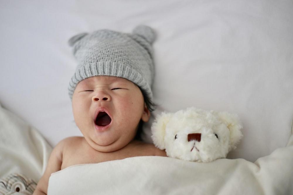 Sleeping baby yawning.