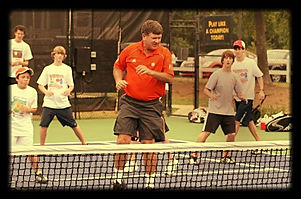 kriese_conducting_camp_for__Tennis_Dynamics__in_Atlanta_op_696x464_edited.jpg