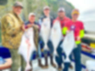 Guests with ther Halibut Charter Catch