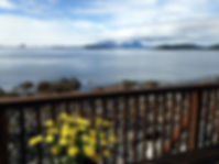 Private balcony overlooking the Sitka Sound and Mt Edgecumbe at Cascade Creek Inn & Charters