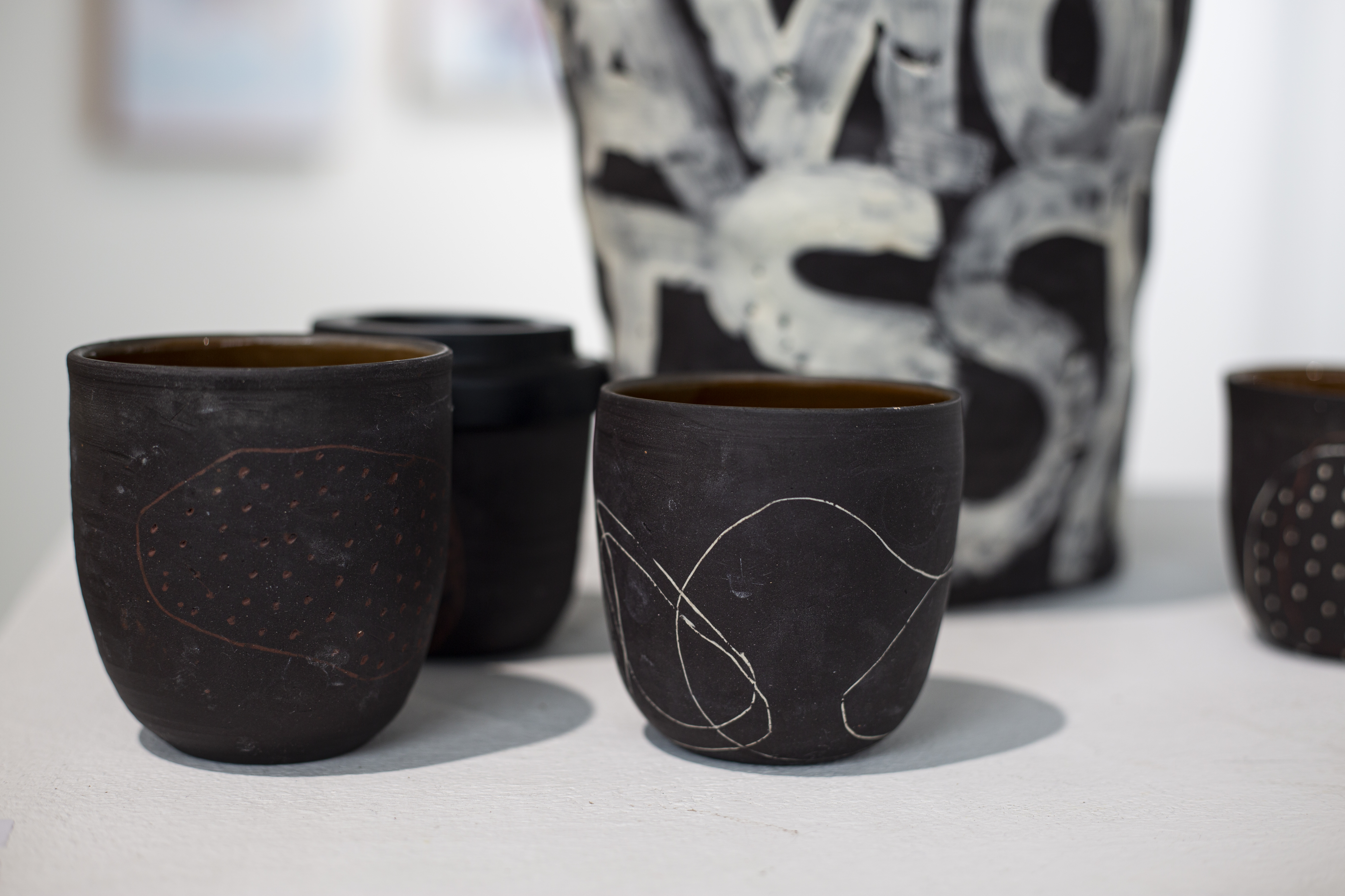 Capitalism (keep cups) by Kara Wood