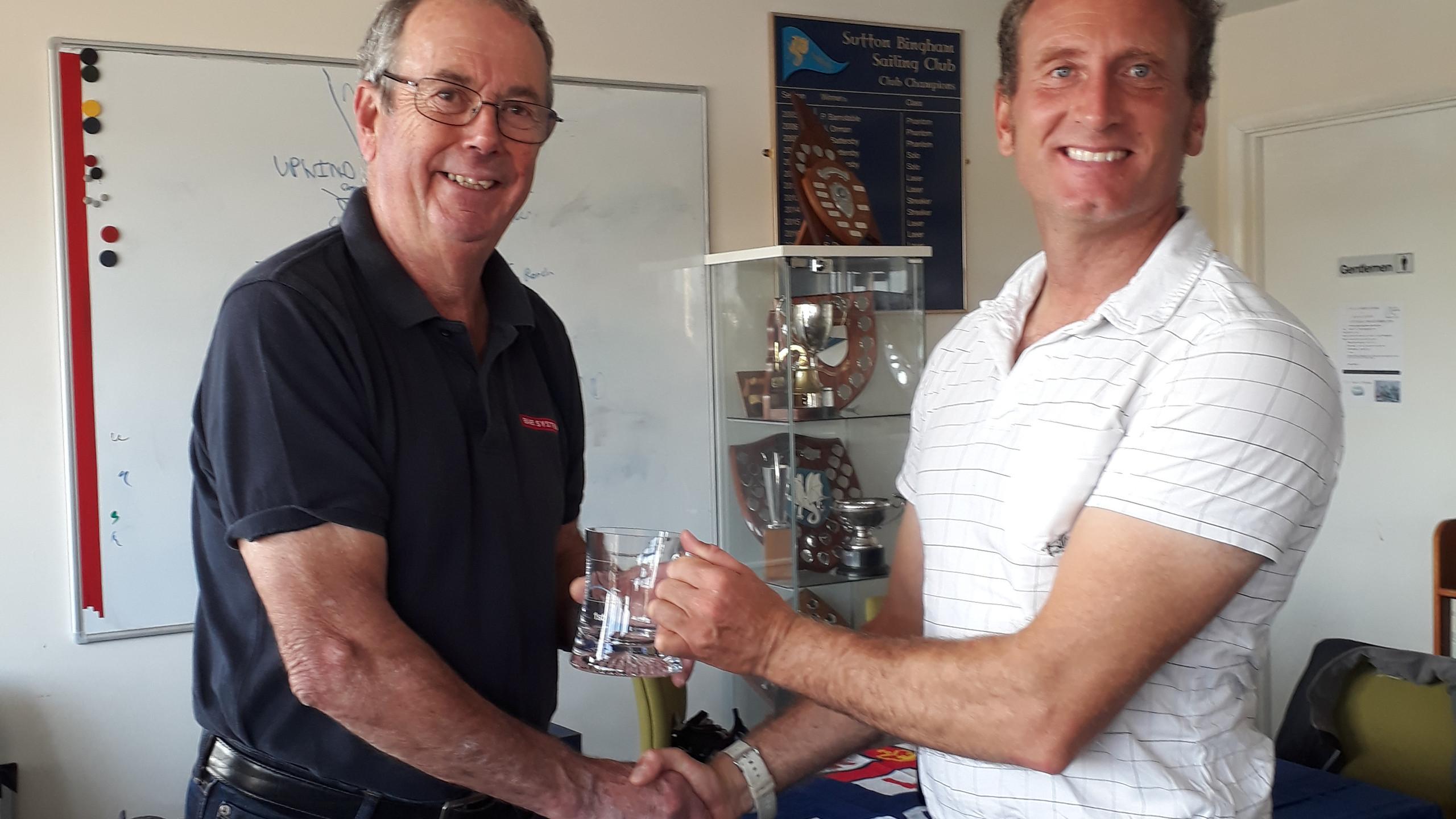 Mervyn Clark congratulates Laser Standar