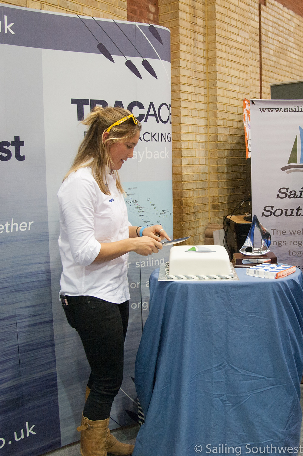British Sailor Sophie Ainsworth cuts the cake