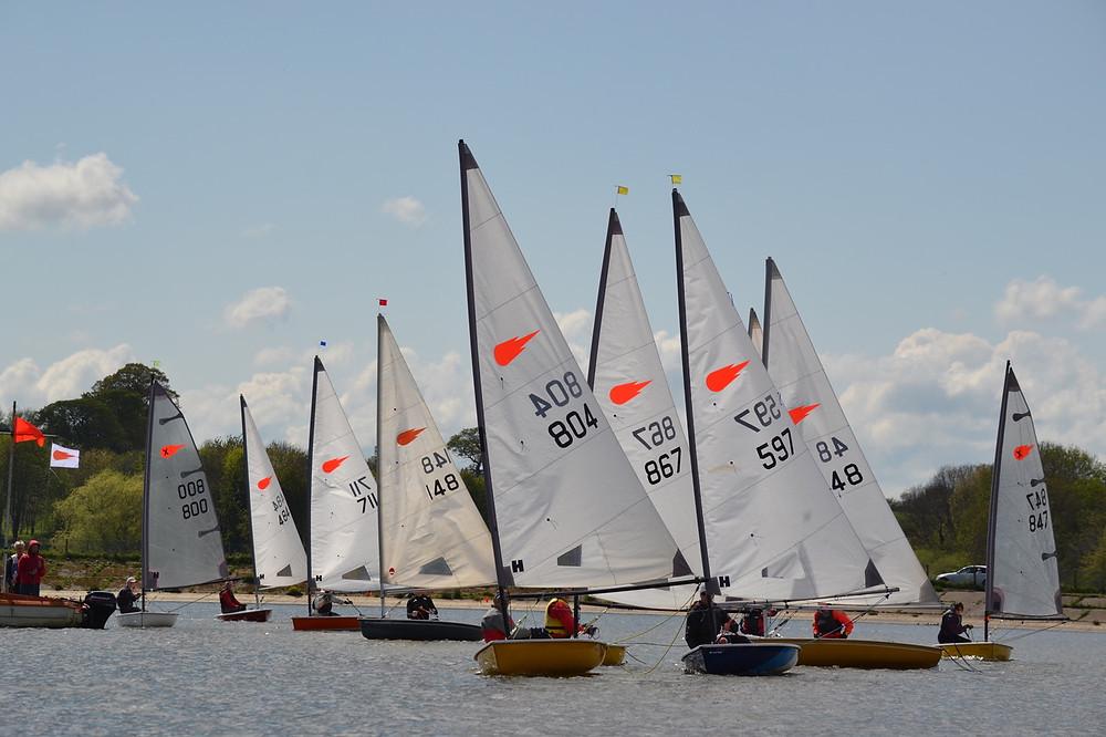 Comet Sailors line up for the final race at Sutton Bingham