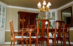 Dining room wooden table with fresh painted walls