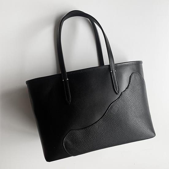 Black on black leather bag